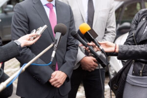 Journalists conducting media interview with businessman